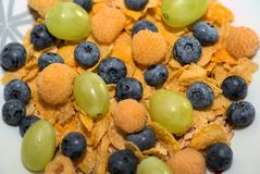 Corn flakes with fruit stock photos