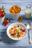 Corn flakes with fruit and milk Royalty Free Stock Image