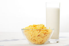 Corn flakes and glass of milk on table Royalty Free Stock Photography