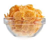 Corn flakes heap in a glass bowl Stock Photos