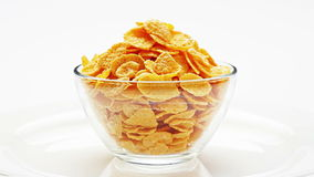 Corn flakes heap in a glass bowl rotating stock video footage