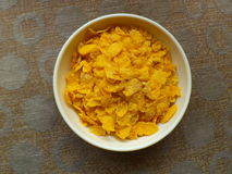 Corn flakes. Inside a plastic bowl Stock Photos