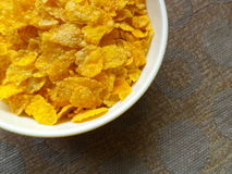 Corn flakes. Inside a plastic bowl Royalty Free Stock Photo