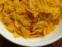 Corn flakes. Inside a plastic bowl Royalty Free Stock Image