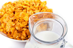 Corn flakes and jug of milk Stock Images