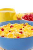 Corn flakes and milk in bowl on white Stock Photos