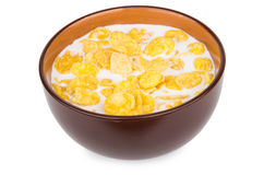 Corn flakes with milk in bowl  on white Royalty Free Stock Photo