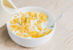 Corn flakes with milk. Corn flakes with fresh milk Stock Photo