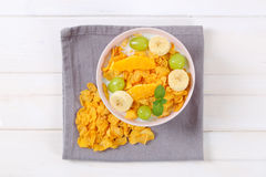Corn flakes with milk and fresh fruit Royalty Free Stock Photography