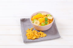 Corn flakes with milk and fresh fruit Stock Photography