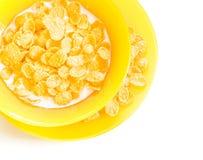 Corn flakes with milk. In orange bowl Royalty Free Stock Photos