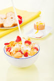 Corn flakes with milk and strawberries. Cereals Stock Photos