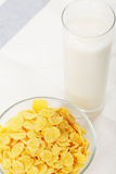 Corn flakes and milk on table Royalty Free Stock Photos