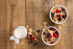 Corn flakes or muesli with fresh berries Stock Images