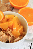 Corn flakes with orange fruit Royalty Free Stock Images