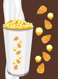 Corn flakes and popcorn in a paper cup on the dark brown background Stock Images