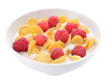Corn flakes and raspberries with yogurt Royalty Free Stock Photography