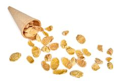 Corn flakes scattered from ice cream waffle cone royalty free stock image