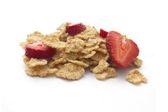 Corn flakes with srawberries  isolated on white Stock Photography