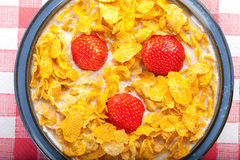 Corn Flakes With Strawberries. Cereal In A Bowl With Milk And Strawberries Stock Photography