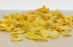Corn flakes and texture, for morning breakfast. On wood background Royalty Free Stock Photography