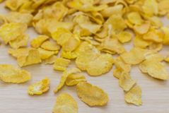 Corn flakes and texture, for morning breakfast. Yellow corn flackes on wood background for morning breakfast Stock Image