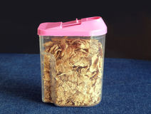 Corn flakes in transparent plastic container closeup Royalty Free Stock Photo