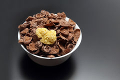 Corn flakes in a white bowl Stock Image