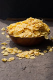 Corn flakes in wooden bowl Stock Image