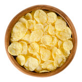 Corn flakes in wooden bowl over white Royalty Free Stock Photography