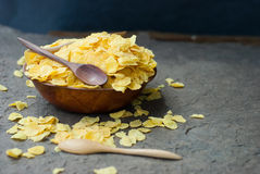 Corn flakes in wooden bowl with spoons Royalty Free Stock Photography