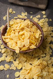 Corn flakes in wooden bowl with spoons and Red heart Royalty Free Stock Image