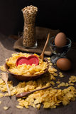 Corn flakes in wooden bowl with spoons and Red heart Royalty Free Stock Images