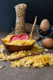 Corn flakes in wooden bowl with spoons and Red heart Stock Photos