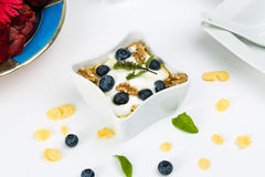 Corn flakes with yoghurt, honey, walnuts and blueberries Stock Images