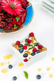 Corn flakes with yoghurt, honey, walnuts raspberries and blueber Royalty Free Stock Photos