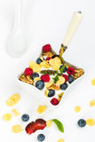 Corn flakes with yoghurt, honey, walnuts raspberries and blueber Stock Photos