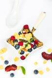 Corn flakes with yoghurt, honey, walnuts raspberries and blueber Royalty Free Stock Photo
