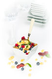 Corn flakes with yoghurt, honey, walnuts raspberries and blueber Royalty Free Stock Images
