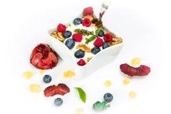 Corn flakes with yoghurt, honey, walnuts raspberries and blueber Stock Image