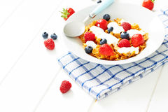 Corn flakes with yogurt and berries on plate Stock Photo