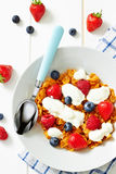 Corn flakes with yogurt and berries on plate Royalty Free Stock Photography