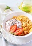 Corn flakesl, yogurt, strawberries and chia seeds Royalty Free Stock Image