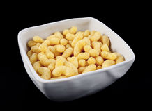 Corn flips in a white bowl. Corn flips in a white ceramic bowl on a white background Royalty Free Stock Photos