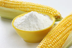Corn flour with corns. Corn starch, cornstarch, cornflour or maize starch or maize is the starch derived from the corn grain. The starch is obtained from the Stock Images