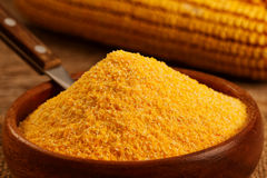 Corn flour. In homemade wooden bowl stock photo