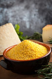 Corn Flour - Italian Polenta. Integral Corn Flour for Italian Polenta with pargiano and rosemary Royalty Free Stock Images