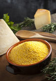 Corn Flour - Italian Polenta. Integral Corn Flour for Italian Polenta with pargiano and rosemary Royalty Free Stock Photography