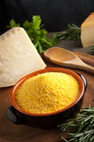 Corn Flour - Italian Polenta. Integral Corn Flour for Italian Polenta with pargiano and rosemary Stock Image