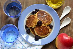 Corn flour pancakes with berries and honey Royalty Free Stock Images